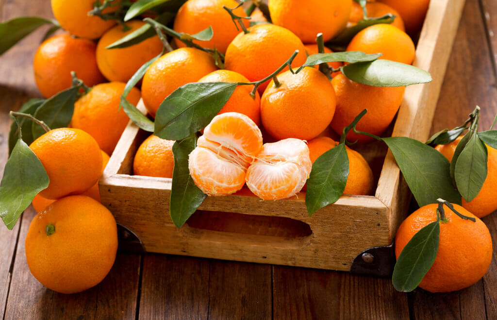 Fresh mandarin oranges fruit or tangerines in the wooden box